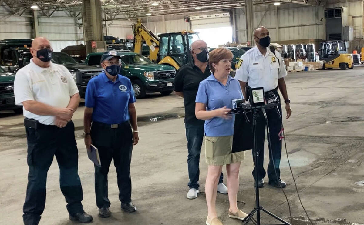 Albany Mayor Kathy Sheehan, center, holds a press conference with other city officials about preparations Albany is making before Hurricane Henri reaches the area.