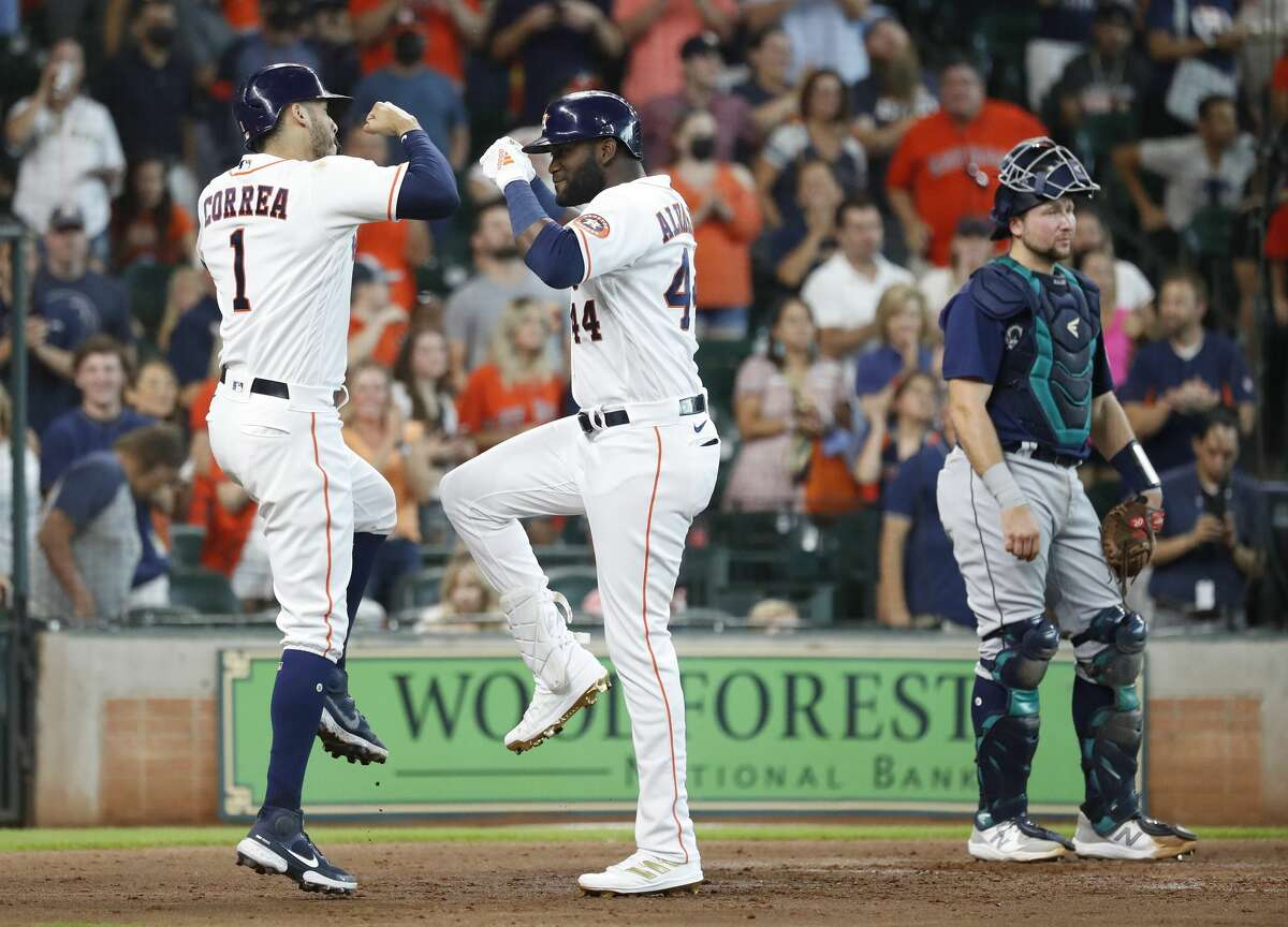 Houston Astros Yordan Alvarez celebrates his three-run home run off Seattle Mariners starting pitcher Logan Gilbert with Carlos Correa during the third inning of an MLB baseball game at Minute Maid Park, Saturday, August 21, 2021, in Houston.