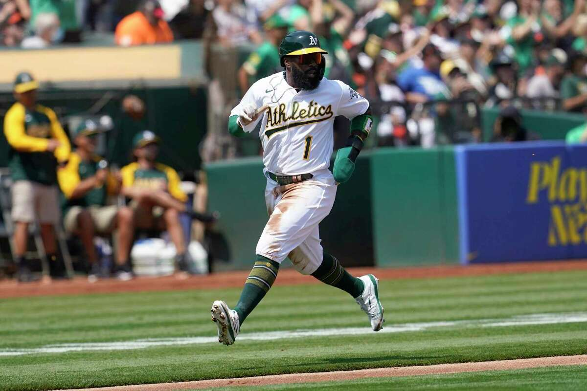 Oakland Athletics' Josh Harrison runs to score against the San Francisco Giants during the first inning of a baseball game in Oakland, Calif., Saturday, Aug. 21, 2021. (AP Photo/Jeff Chiu)
