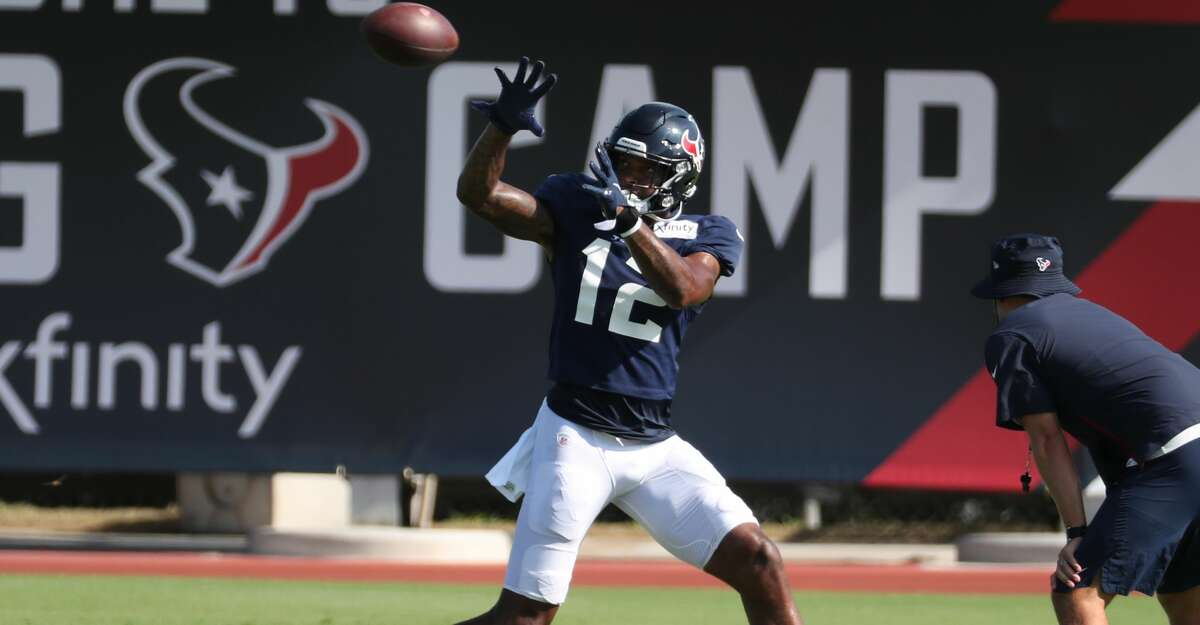Houston Texans wide receiver Nico Collins (12) reaches out to make a catch during an NFL training camp football practice Wednesday, Aug. 18, 2021, in Houston.