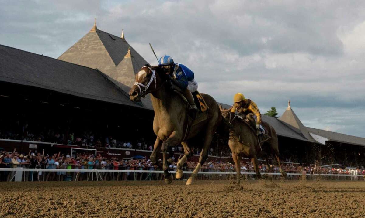 The New York Racing Association on Sunday required that all employees and vendors at the track to wear masks or other face coverings amid the local and statewide increase in coronavirus cases. Malathaat with jockey John Velazquez wins the 141st running of The Alabama at the Saratoga Race Course on Saturday.