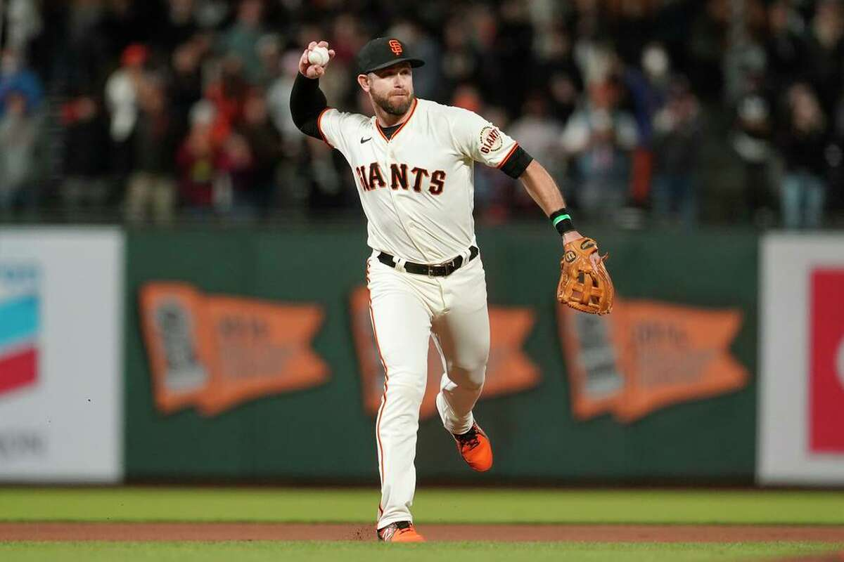San Francisco Giants third baseman Evan Longoria throws out New York Mets' Jeff McNeil during the ninth inning of a baseball game in San Francisco, Monday, Aug. 16, 2021. (AP Photo/Jeff Chiu)
