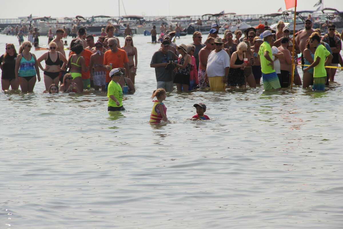 The Caseville County Park beach was the site of noodle, cardboard boat, and paddleboard races on Saturday afternoon during the last weekend of this year's Cheeseburger festival. The night wrapped up with a show from Johnny Russler and the Beach Bum band.