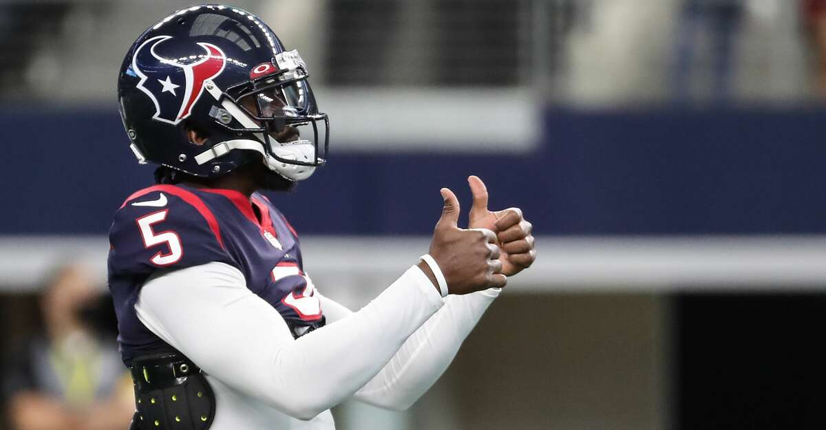 Houston Texans quarterback Tyrod Taylor gives a thumbs up as he warms up before an NFL pre-season football game Saturday, Aug. 21, 2021, in Arlington.