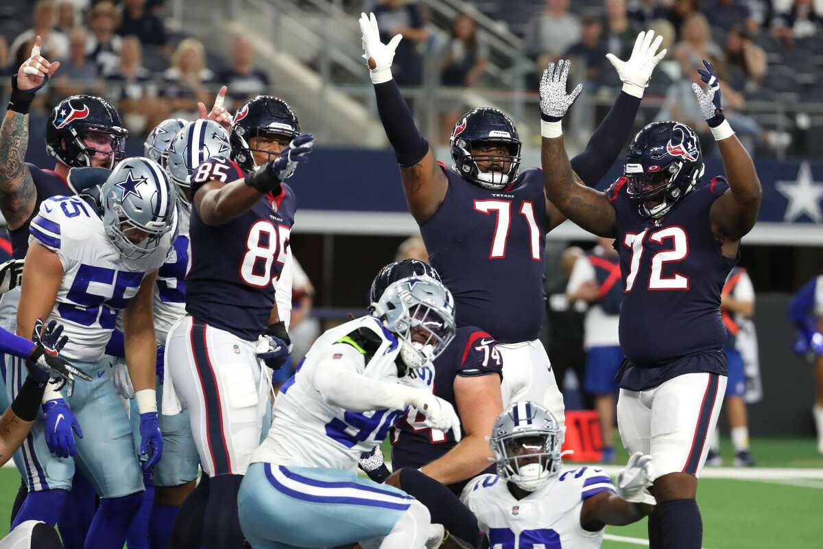 Houston Texans tight end Pharaoh Brown (85), tackle Tytus Howard (71) and offensive tackle Geron Christian Sr. (72) signal touchdown running back Mark Ingram II pushed the ball over the goal line for a 2-yard scoring run against the Dallas Cowboys during the first quarter of an NFL pre-season football game Saturday, Aug. 21, 2021, in Arlington.