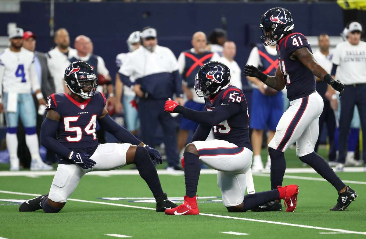 Houston Texans defensive end Jacob Martin (54), Whitney Mercilus (59) and linebacker Zach Cunningham (41) celebrate the Texans recovering a Dallas Cowboys fumble during the first quarter of an NFL pre-season football game Saturday, Aug. 21, 2021, in Arlington.