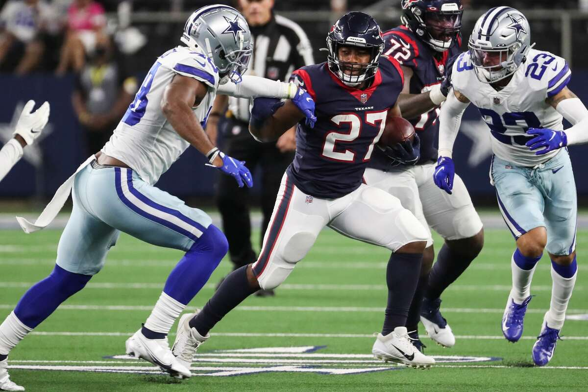 Houston Texans running back Scottie Phillips (27) runs the ball against the Dallas Cowboys defense during the second half of an NFL pre-season football game Saturday, Aug. 21, 2021, in Arlington.