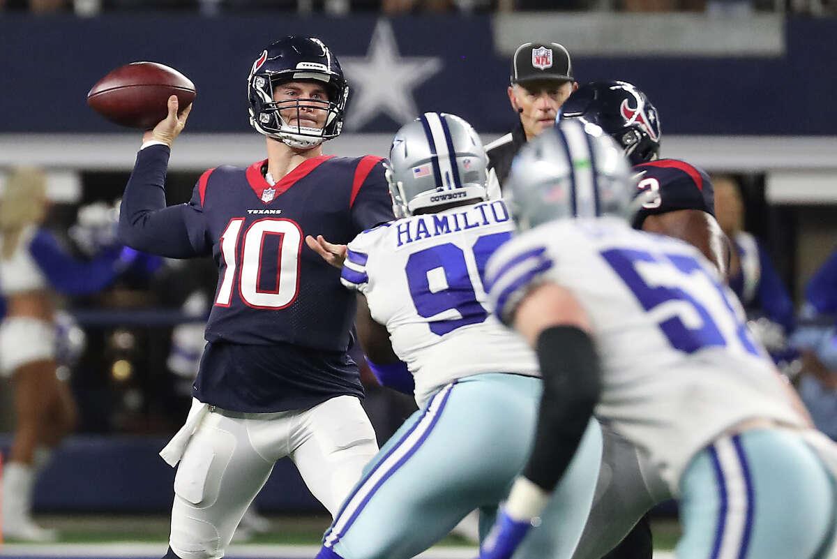 Houston Texans quarterback Davis Mills (10) passes against the Dallas Cowboys during the second half of an NFL pre-season football game Saturday, Aug. 21, 2021, in Arlington.