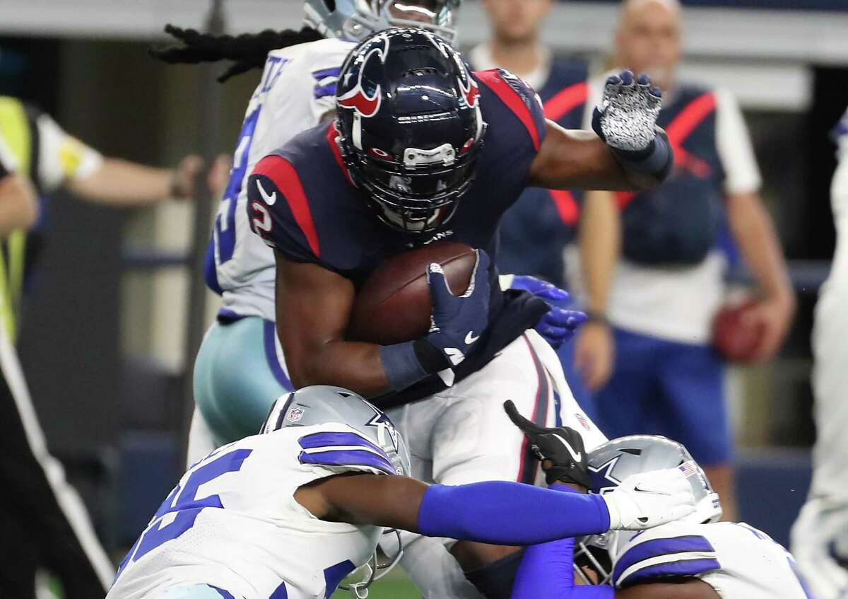 Houston Texans running back Mark Ingram II (2) is hit by Dallas Cowboys safety Damontae Kazee (35) as he runs the ball during the first quarter of an NFL pre-season football game Saturday, Aug. 21, 2021, in Arlington.