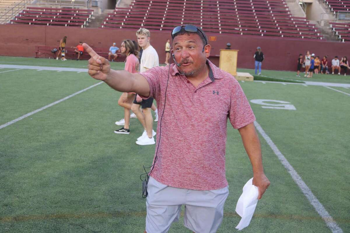 Deer Park boys soccer coach Jerry Hurtado, Saturday night's auctioneer, had the bids going fast and furious during the live auction.