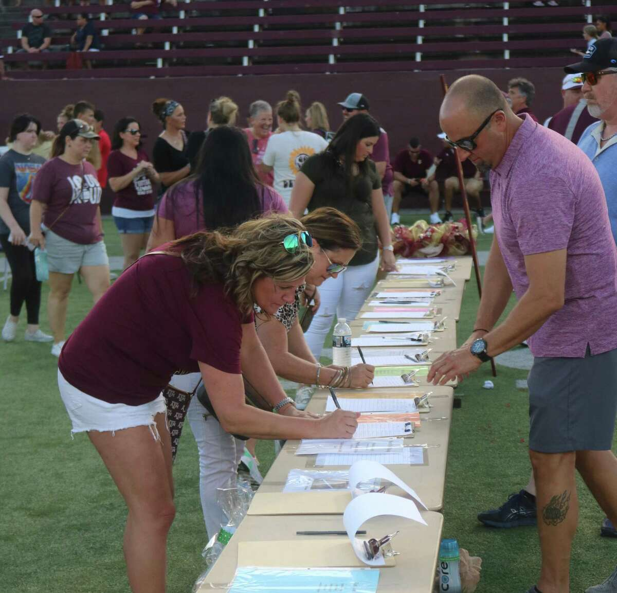 People gladly participated in the silent auction Saturday night, hoping to outbid others for gift baskets.
