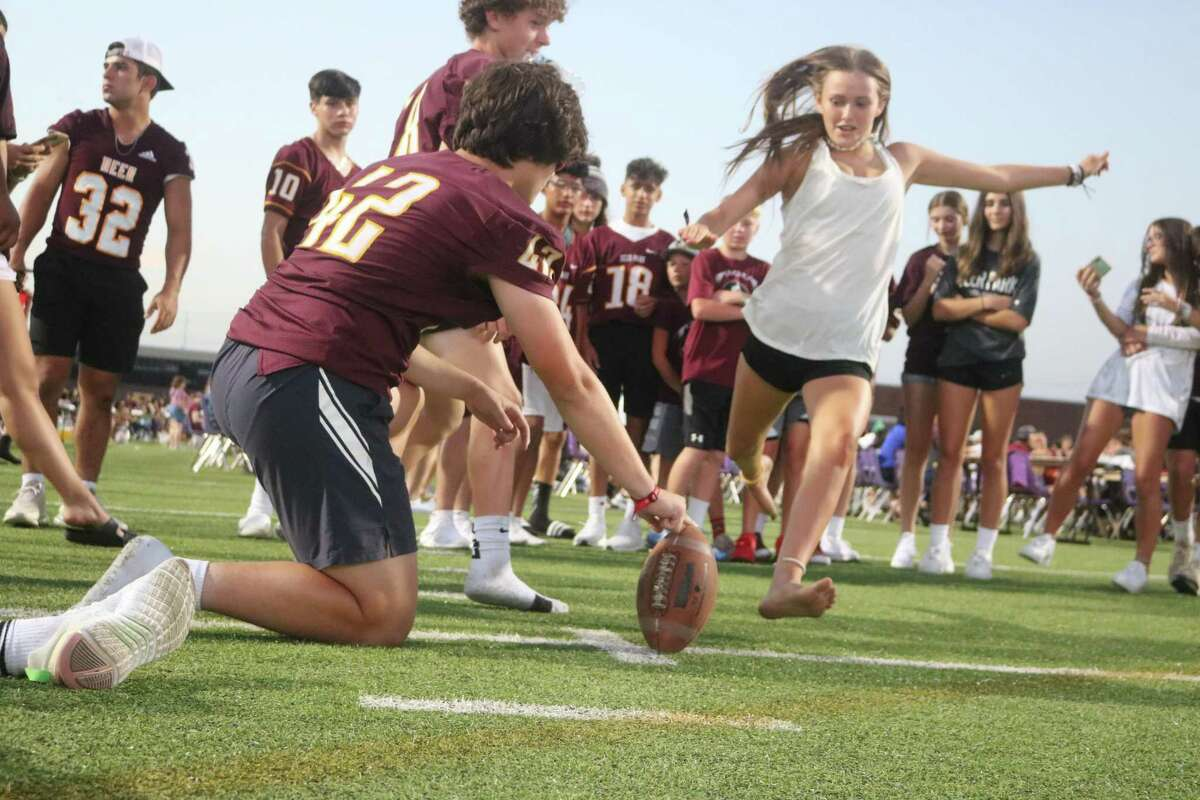 No matter the gender, the challenge of kicking a football through the uprights was too great to ignore at Deer Park's Meet the Team Saturday night.
