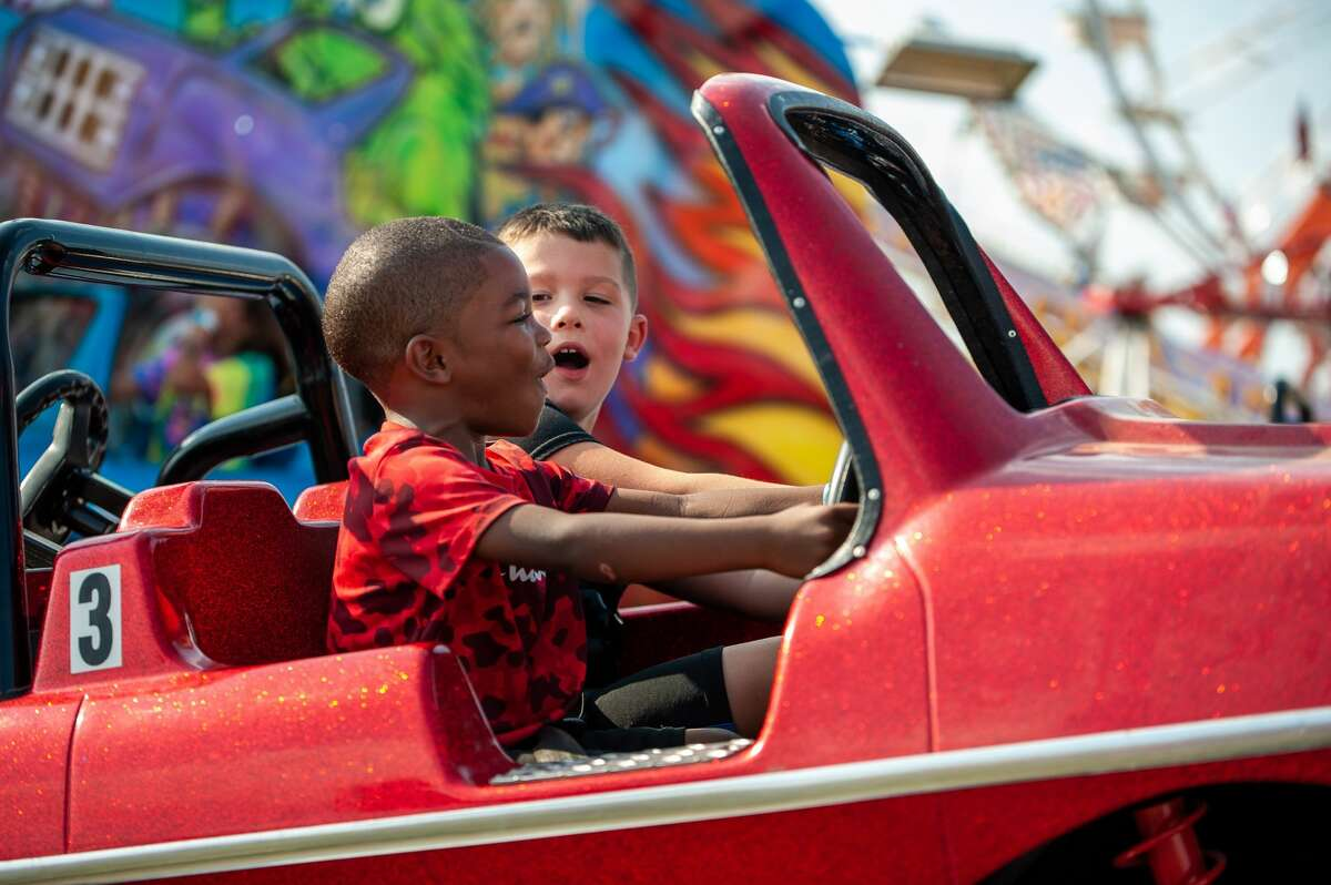 People enjoy rides and looking at animals during the Midland County Fair on Aug. 21, 2021. This was the last day the fair Midway was open (Andrew Mullin/AMullin@hearstnp.com).