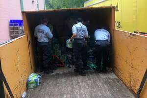 Danbury police explorers and Public Works personnel taking delivery of water for the Danbury shelter.