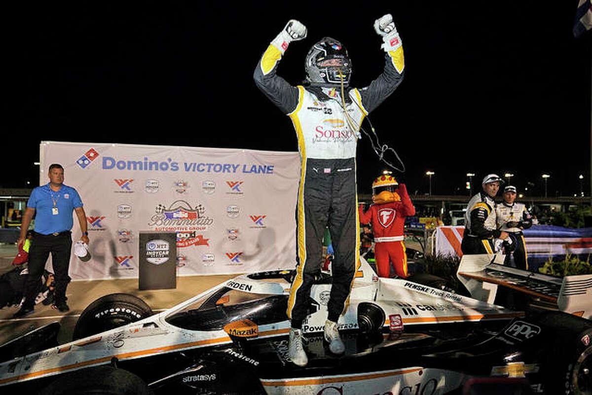 Josef Newgarden celebrates after winning an IndyCar Bommarito 500 race at World Wide Technology Raceway Saturday night in Madison.