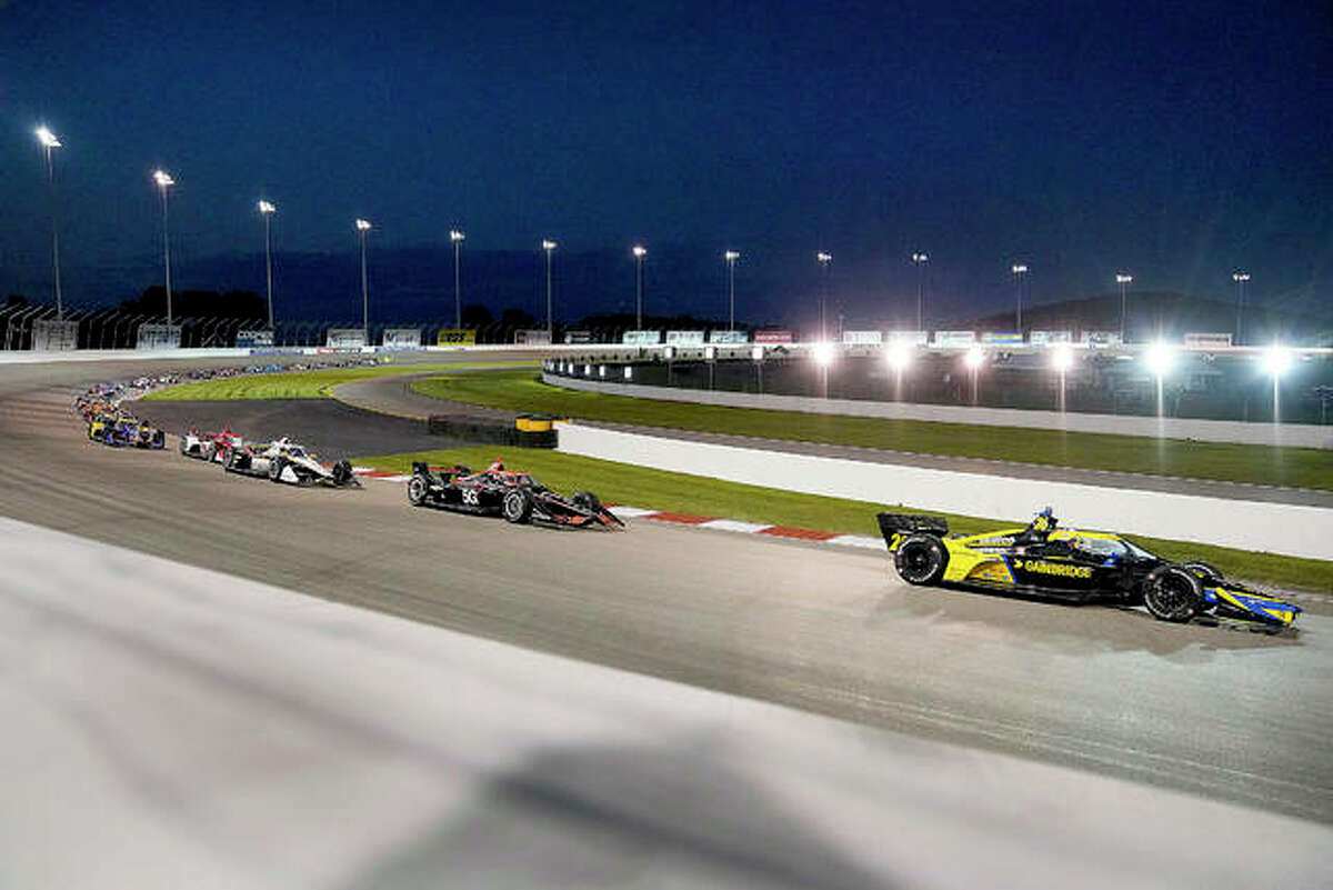 Cars race under the lights during the IndyCar Bommarito 500 Saturday nighty at World Wide Technology Raceway in Madison.