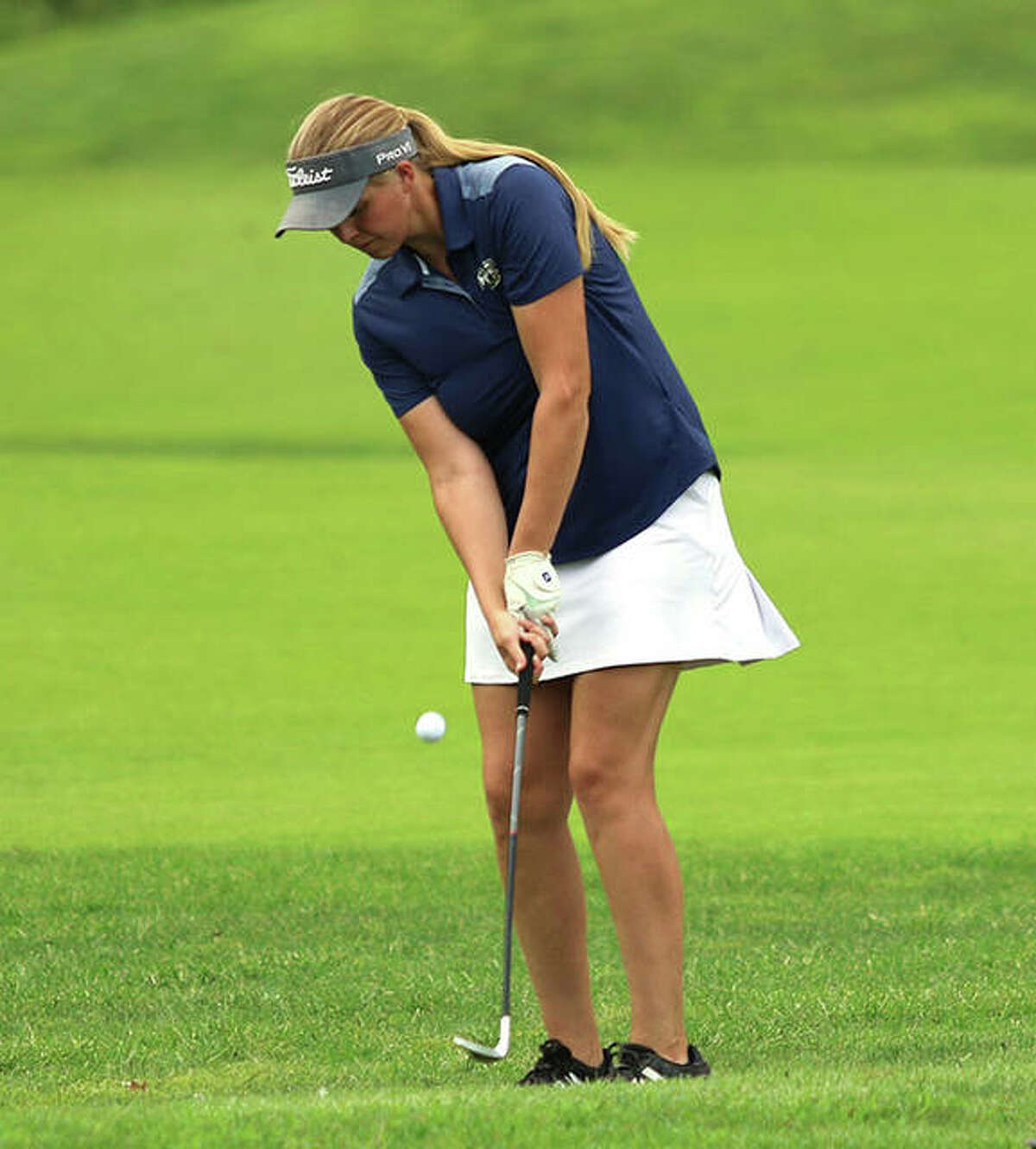 Father McGivney's Julia Stobie chips onto the ninth green at Spencer T. Olin golf course on Saturday at the Marquette Blast-Off Tournament in Alton.