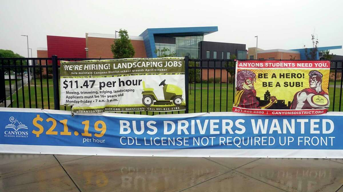 """A """"Bus Drivers Wanted"""" sign is shown Wednesday, Aug. 18, 2021, in Sandy, Utah. A shortage of bus drivers is complicating the start of a new school year already facing a surge in COVID-19 cases and conflicts over whether masks should be required in school buildings."""
