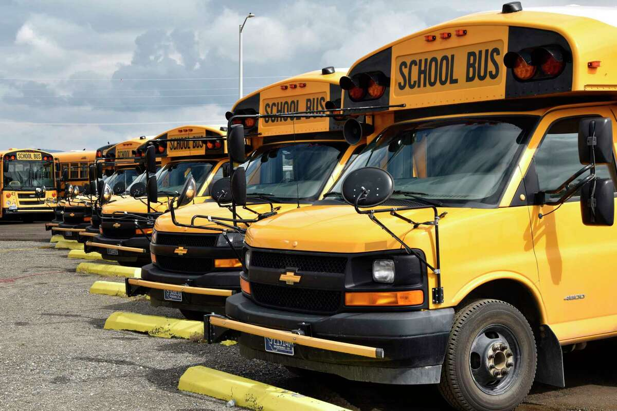 School buses parked in Helena, Mont., ahead of the beginning of the school year, Friday, Aug. 20, 2021. School districts across the country are coping with a shortage of bus drivers, a dilemma that comes even as they struggle to start a new school year during a new surge of the coronavirus pandemic.