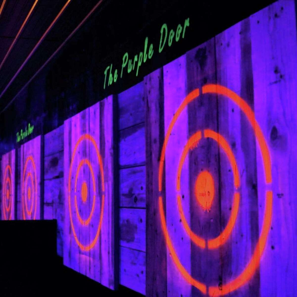 The Purple Door features eight ax-throwing lanes, shuffleboard, darts, and food and drinks from next-door establishments Chill Out and Crusted Creations 231. (Courtesy/Chuck Wohlford)
