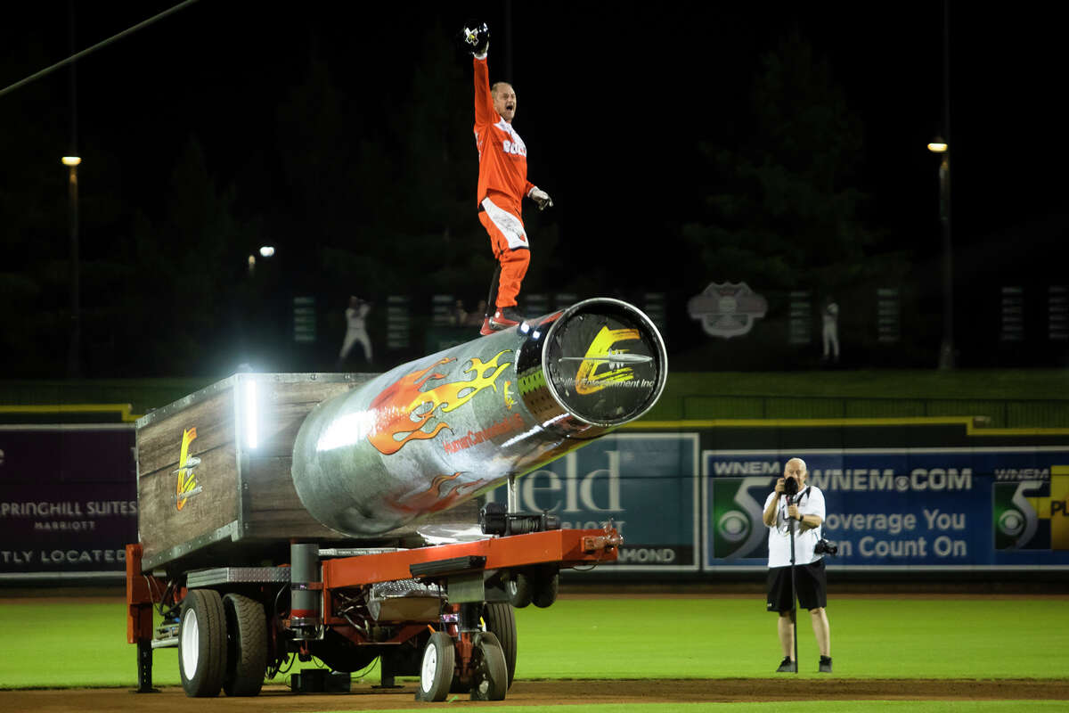 """David """"The Bullet"""" Smith launches himself out of a cannon after the Great Lakes Loons' game against the Lansing Lugnuts Friday, Aug. 20 at Dow Diamond. (Katy Kildee/kkildee@mdn.net)"""