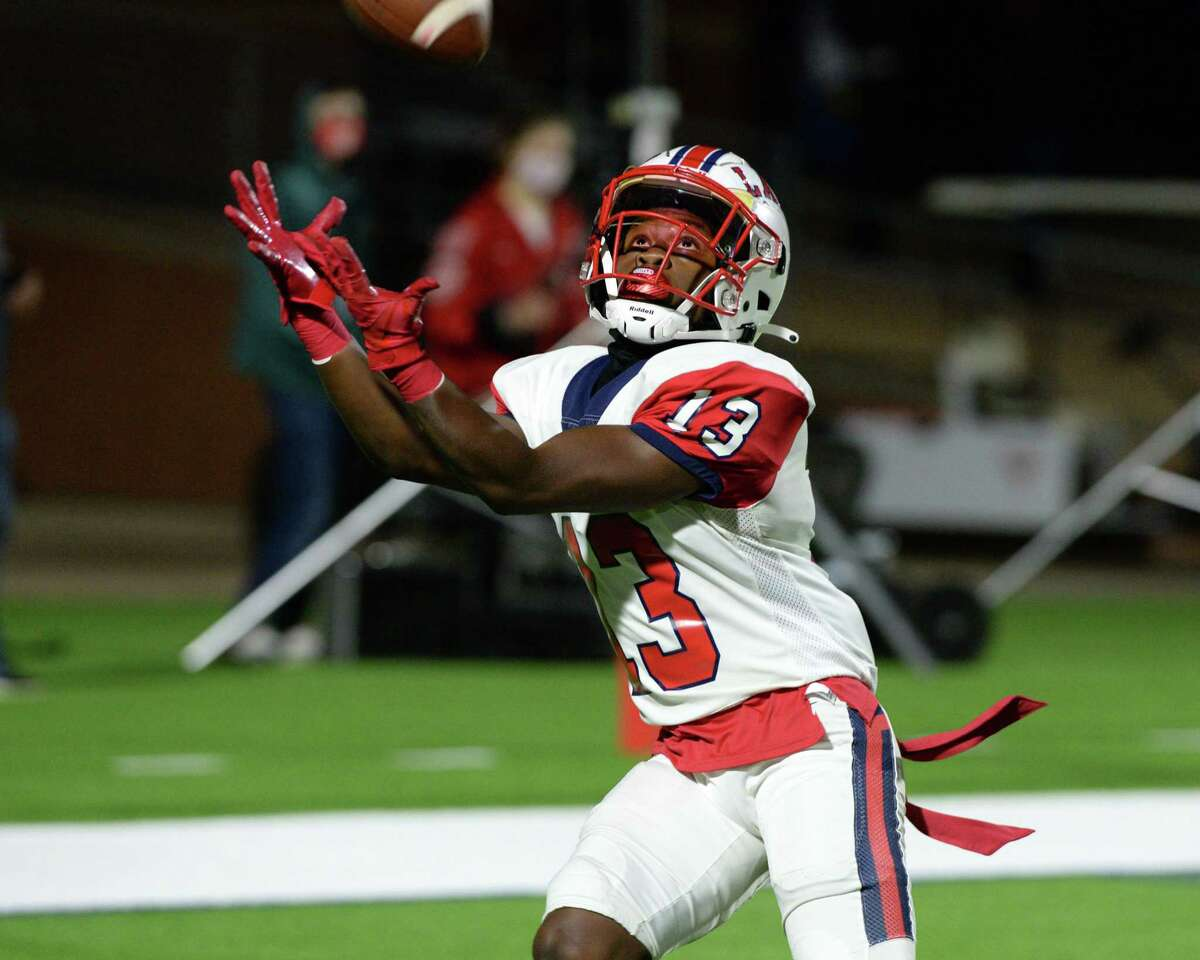 Terrence Rone (13) of Lamar fields the opening kickoff of a Class 6A Region III Division II area round football game between the Lamar Texans and the Katy Tigers on Friday, December 18, 2020 at Rhodes Stadium in Katy, Texas.