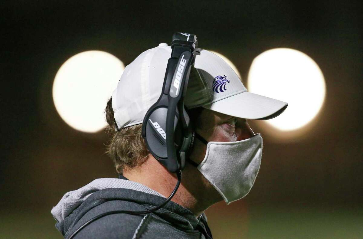 Kinkaid Falcons head coach Nathan Earned watches play against the Episcopal Knights in the second quarter of a game on November 6, 2020 at Segal Field at Barnard Stadium in Houston, TX.