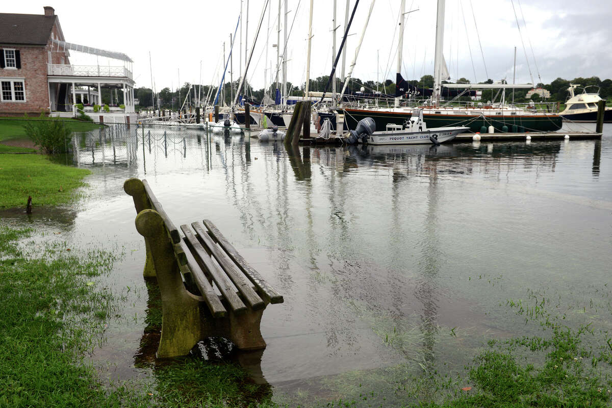 High tide brought the waters of Southport Harbor onto Perry's Green, in Fairfield, Conn. Aug 22, 2021. As Tropical Storm Henri passed farther to the east, most of coastal Fairfield County experienced an ordinary rainy day on Sunday.