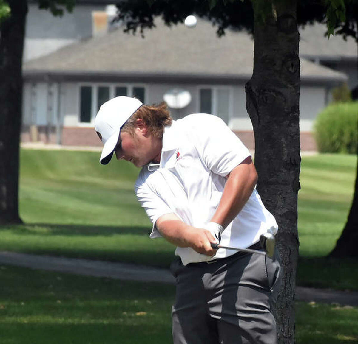 Alton's Alec Schmieder hits a shot during Wednesday's Madison County Meet at Belk Park in Wood River. On Saturday, Schmieder and the Redbirds were at the Quincy Invite and Alton placed ninth at Westview golf course.