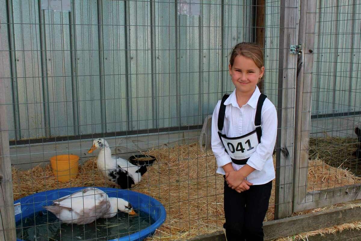 Isabelle Banner and her duck Lemon Meringue. (Kate Goodman/News Advocate)