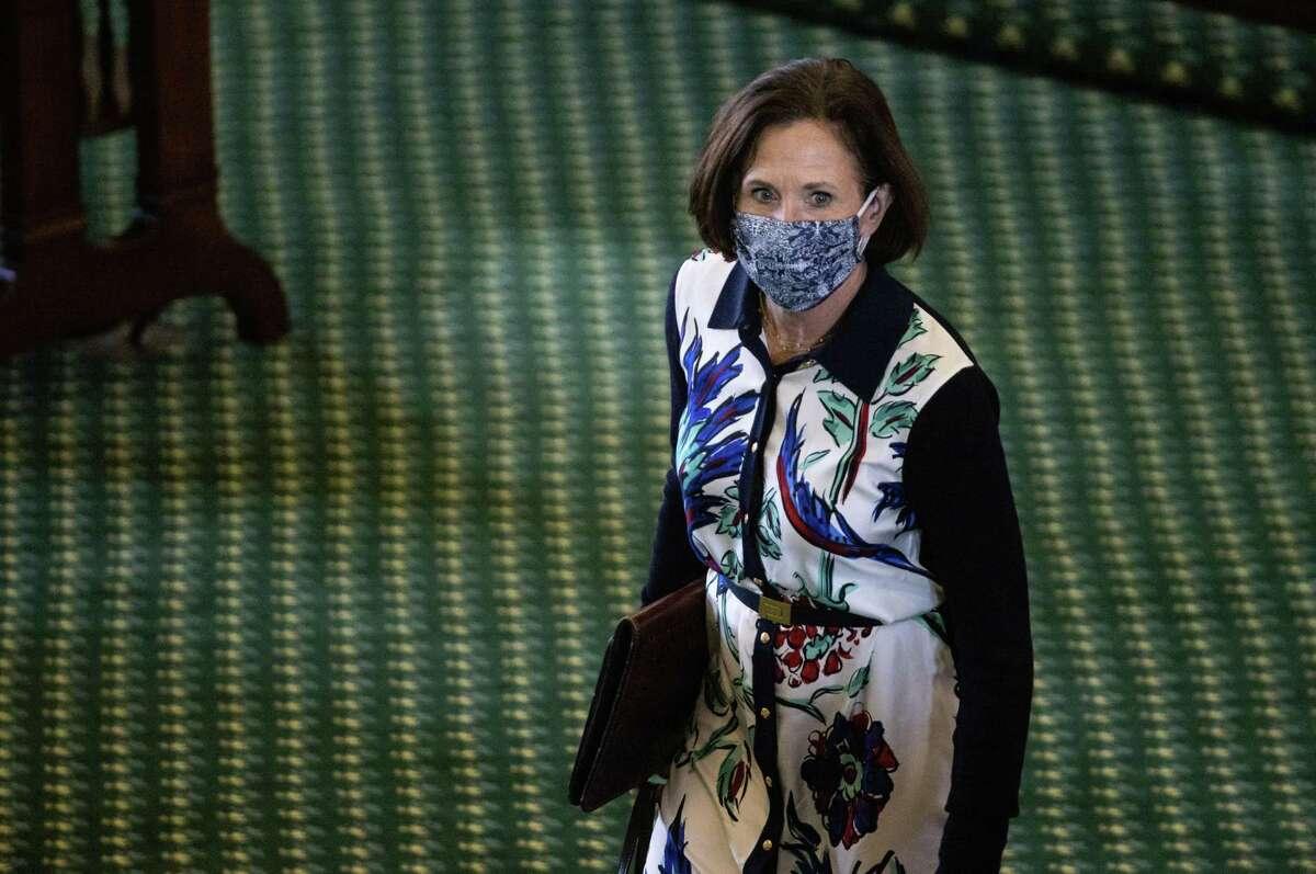 Texas State Senator Lois Kolkhorst (R-Brenham) walks to her desk on the second day of the 87th Texas legislature on Wednesday, Jan. 13, 2021 at the Texas State Capitol, in Austin, Texas. (Lynda M. González/The Dallas Morning News)