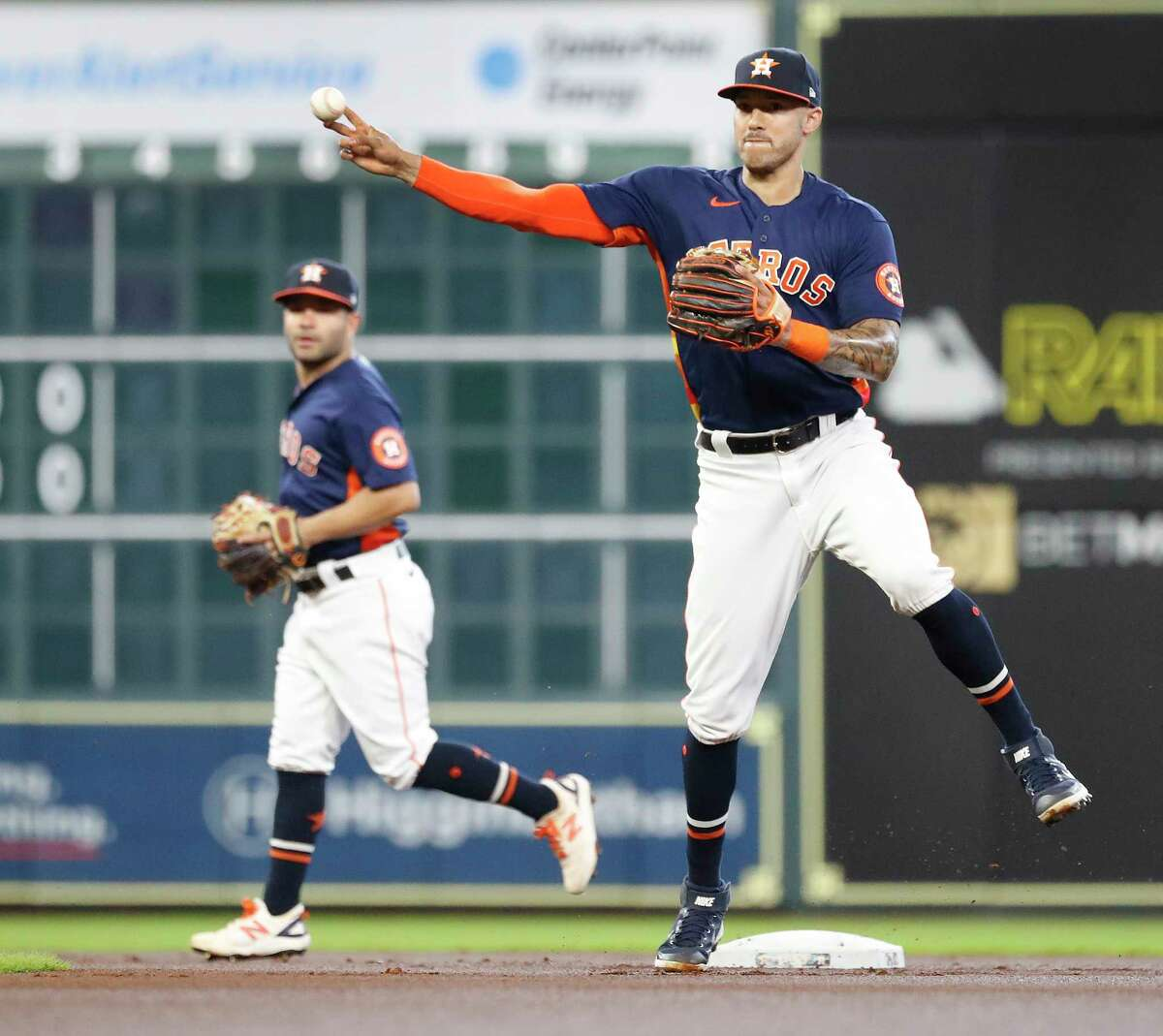 Houston Astros shortstop Carlos Correa (1) makes the throw to first base as Seattle Mariners Ty France ground out to end the top of the first inning of an MLB baseball game at Minute Maid Park, Sunday, August 22, 2021, in Houston.