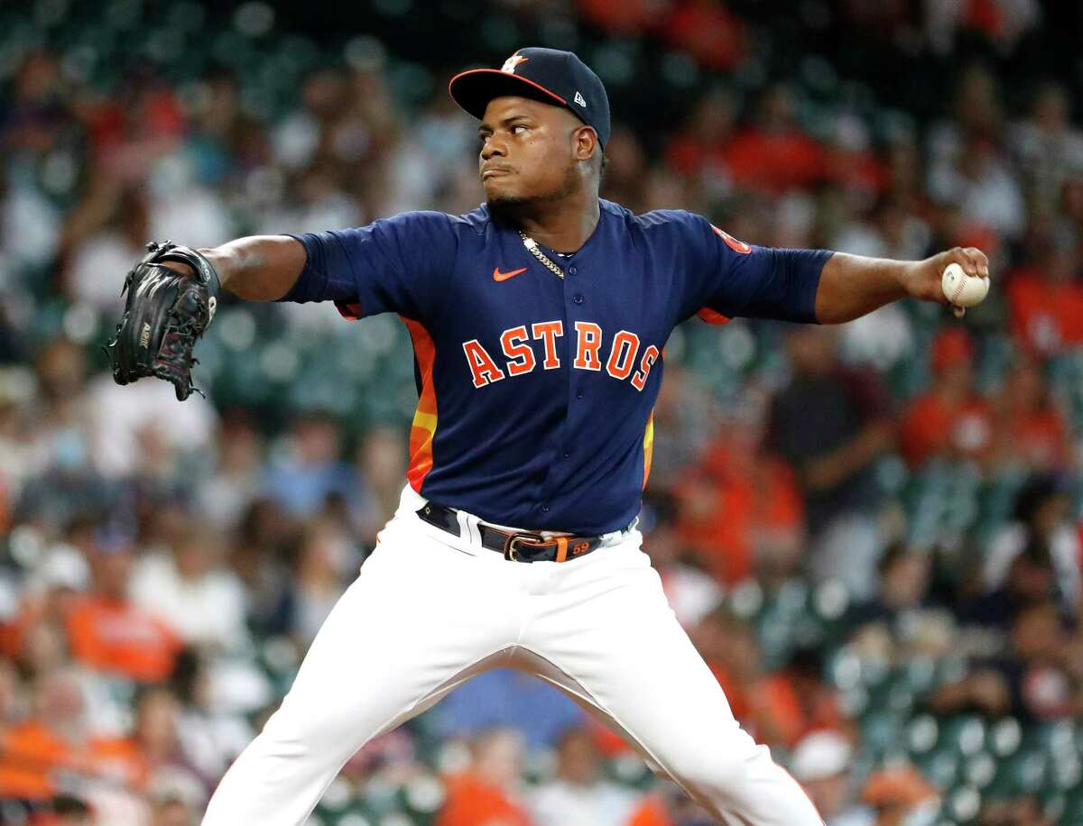 Houston Astros starting pitcher Framber Valdez (59) pitches to Seattle Mariners J.P. Crawford (3) during the first inning of an MLB baseball game at Minute Maid Park, Sunday, August 22, 2021, in Houston.