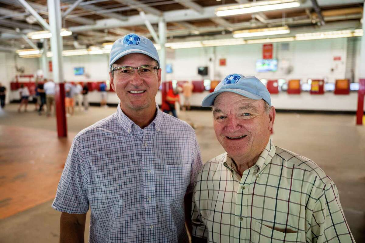 Fast friends John O'Shea, left, and Bill Babin, both Louisiana natives and owners of Al Stall trainee and Travers entrant Masqueparade, hang out in the clubhouse at Saratoga Race Course on Sunday, Aug. 22, 2021, in Saratoga Springs, N.Y.