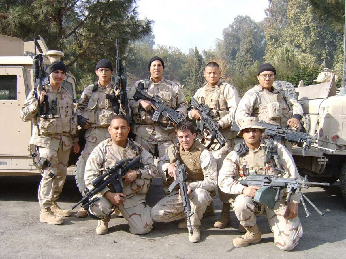 Ricardo Quijano is pictured with a group of Marines in Jalalabad, Afghanistan.