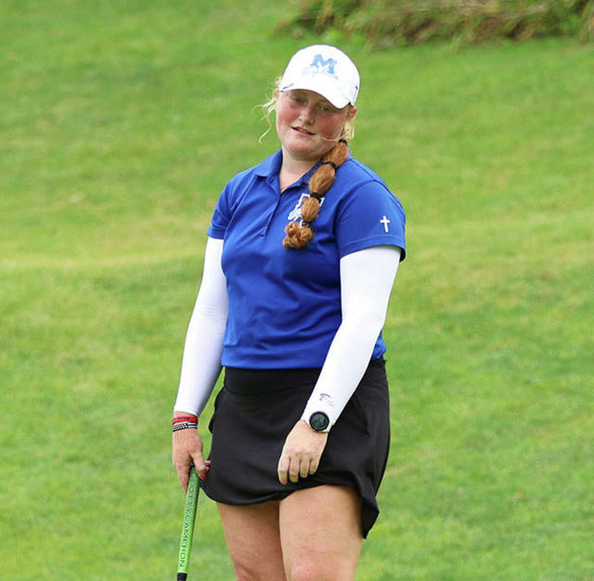 Marquette's Gracie Piar reacts as her birdie putt an inch or two short of the cup on hole No. 12 at the Blast Off Tourney on Saturday at Olin. Piar made five birdie putts and two more for eagle while shooting a 6-under par 66 to win the tourney by four shots.