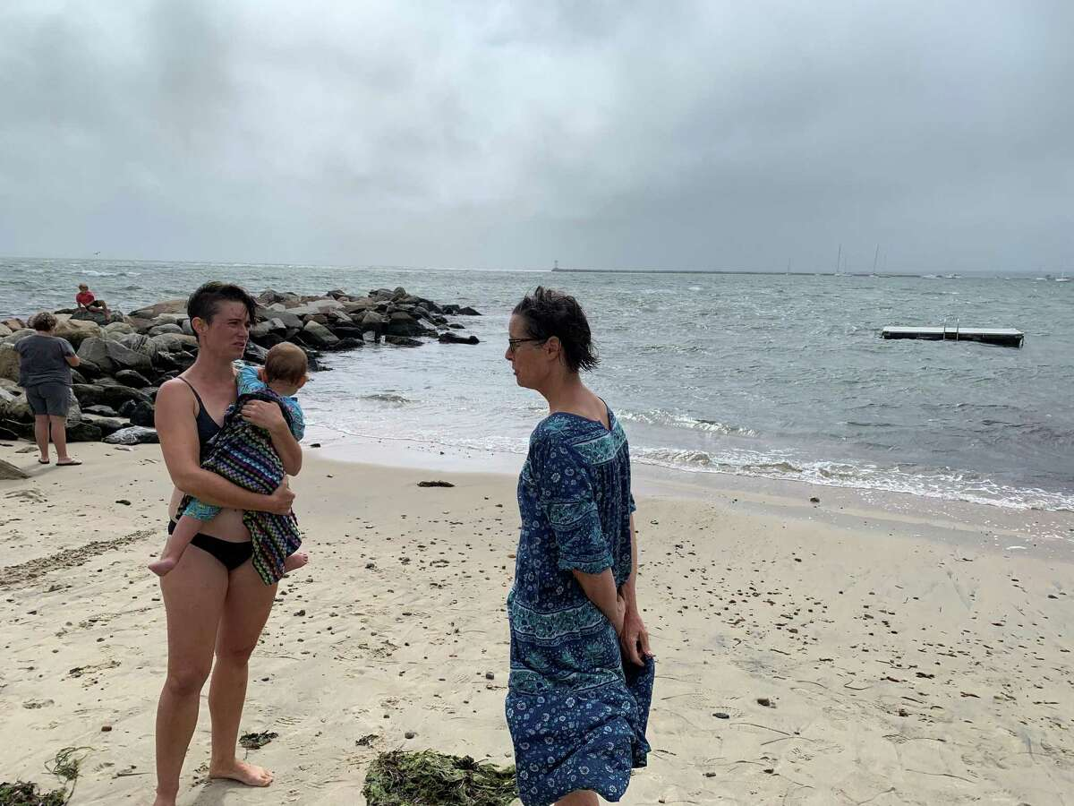 Janis Mink, of Stonington, right, went to DuBois Beach Sunday afternoon after Tropical Storm Henri with her daughter, Louisa, and granddaughter, Ray.