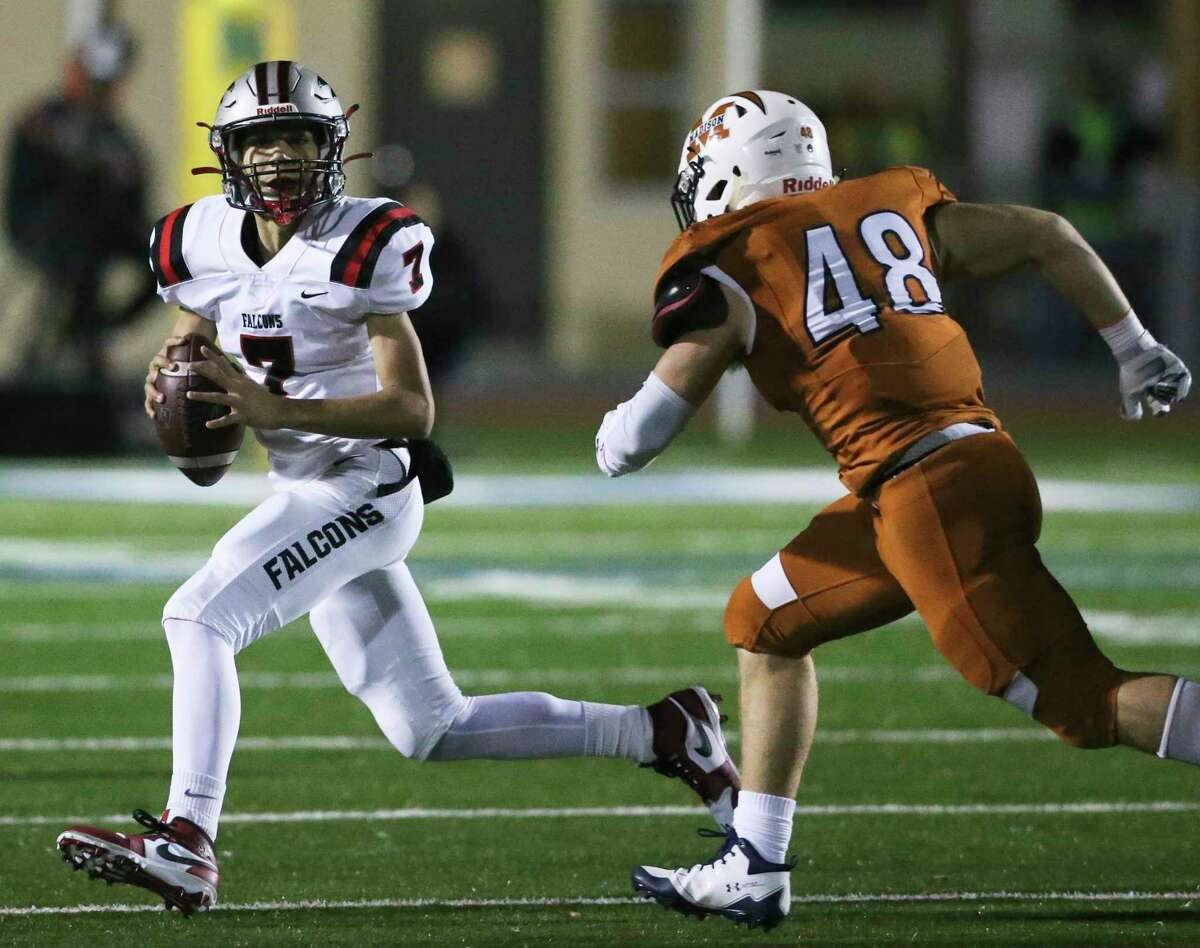 Stevens quarterback KK Brashears runs away from the pressure of Madison linebacker Logan Bomer in the first round of the playoffs at Commalander Stadium on Nov. 15, 2019.