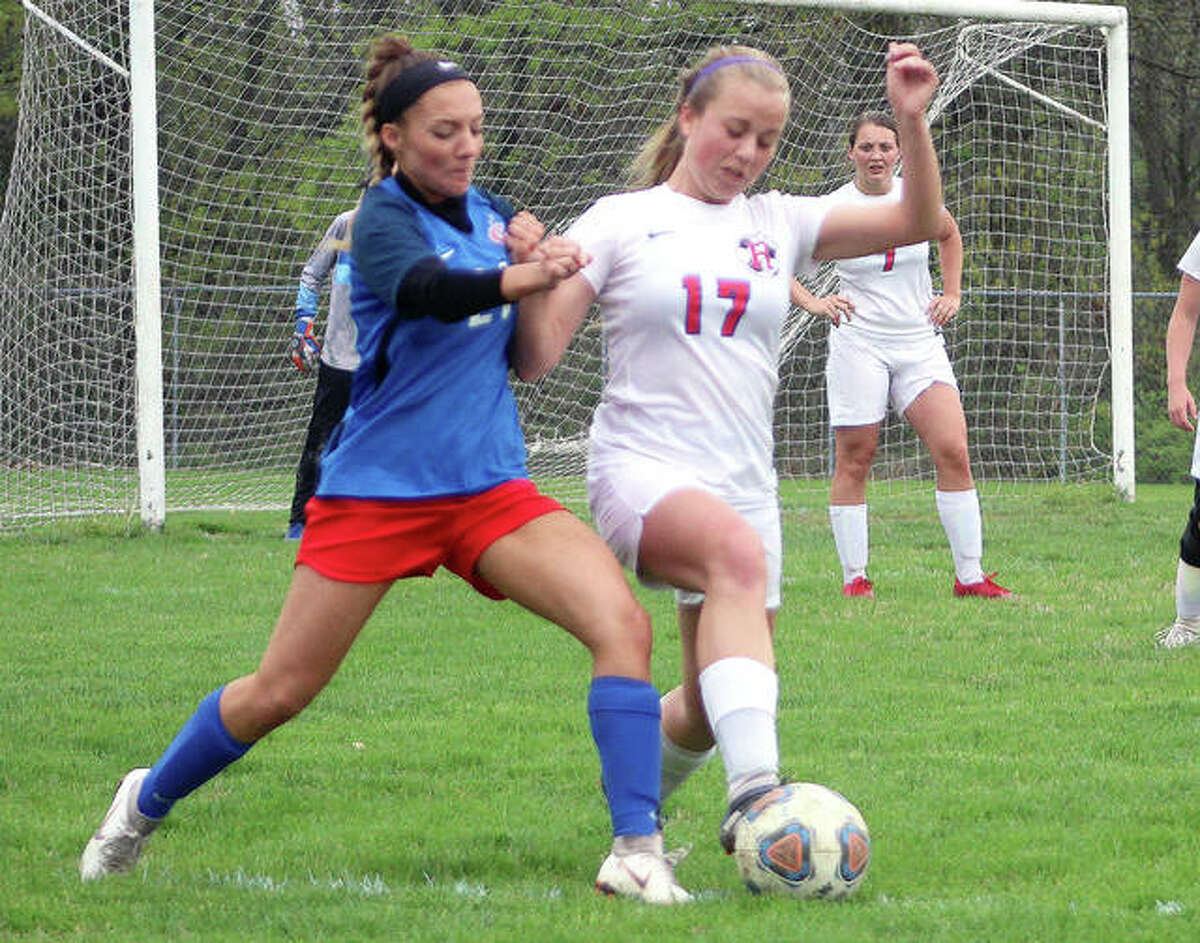 LCCC's Skylar Nickel of Carlinville, left and Olivia Mouser of Roxana battle for possession of the ball in a 2019 game during their high school days. Now teammates at Lewis and Clark, each scored a goal to lead the Trailblazers to a 2-1 win over College of Lake County Sunday in Grayslake.