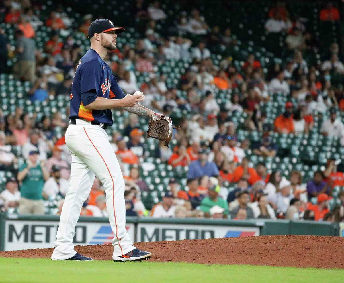Houston Astros relief pitcher Ryan Pressly (55) reacts after giving up a home run to Seattle Mariners Ty France to tie the game during the ninth inning of an MLB baseball game at Minute Maid Park, Sunday, August 22, 2021, in Houston.
