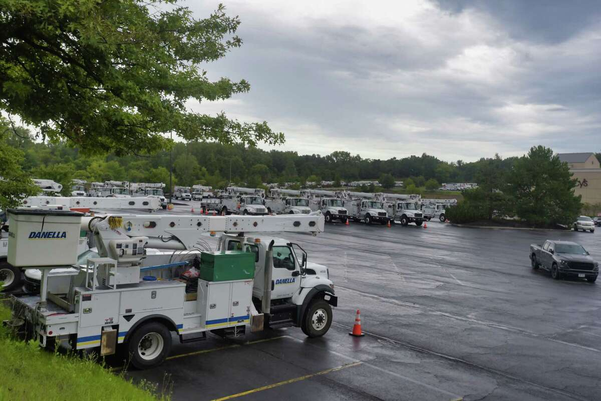 Utility trucks are seen parked at Crossgates Mall on Sunday, Aug. 22, 2021, in Colonie, N.Y. The utility crews have gathered in the area as they wait for word on where they are needed as Tropical Storm Henri comes through the northeast.