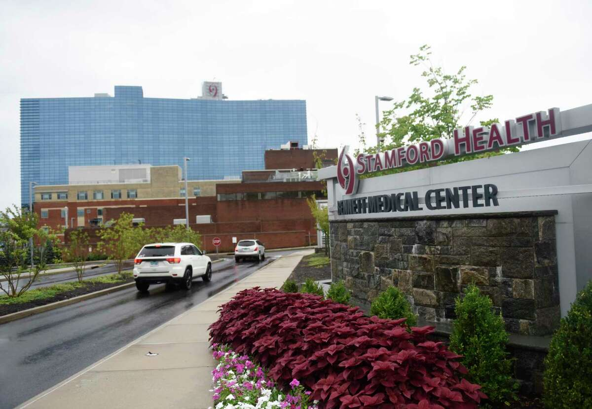 Rain falls on Stamford Hospital as Tropical Strom Henri makes landfall with Stamford, Conn. Sunday, Aug. 22, 2021. Connecticut hospitals have prepared for Tropical Storm Henri by stocking up on food and other supplies and allowing staff members to stay overnight.
