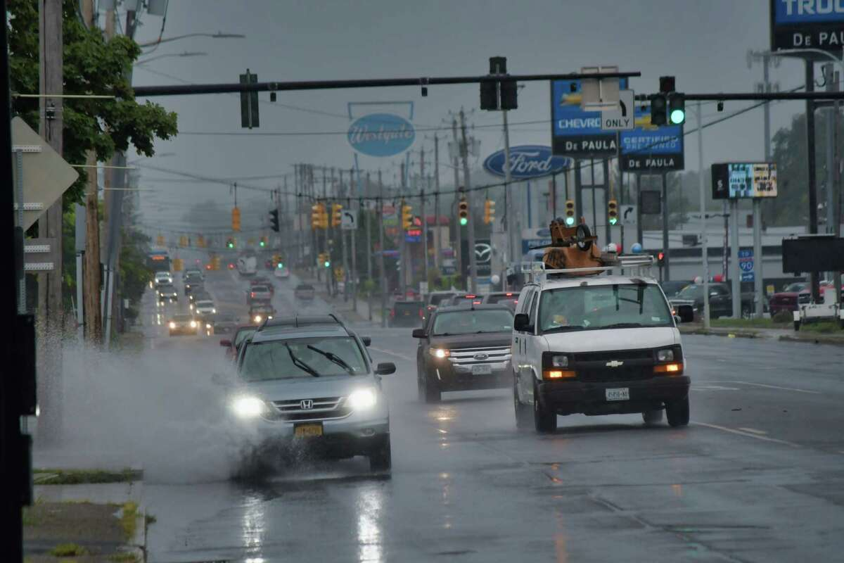 Drivers make their way along Central Ave. as rain from Tropical Storm Henri falls on Sunday, Aug. 22, 2021, in Albany, N.Y.