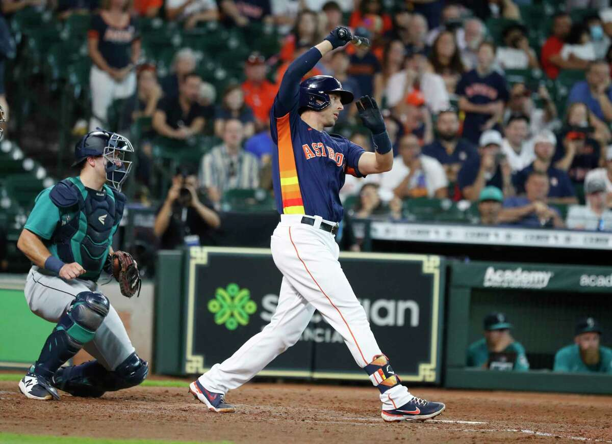 Houston Astros Jason Castro (18) strikes out against Seattle Mariners reliever Paul Sewald during the tenth inning of an MLB baseball game at Minute Maid Park, Sunday, August 22, 2021, in Houston.