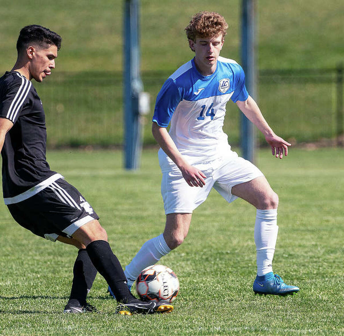 LCCC's Brayden Decker (14), a sophomore from Alton, scored a first-half goal in his team's 2-0 victory over College of Lake County Sunday in Grayslake. LCCC, which also won Saturday 6-1 over Oakton Community College, is 2-0 on the season.