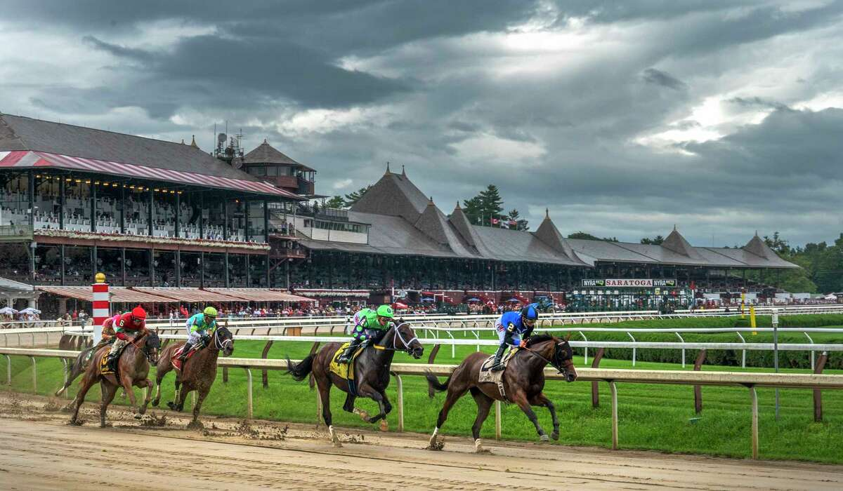 Horologist with jockey Junior Alvarado, right leads in to the Clubhouse turn and ultimately went gat to wire to win the 8th running of The Summer Colony at the Saratoga Race Course Sunday Aug 22, 2021 in Saratoga Springs, N.Y. Photo Special to the Times Union by Skip Dickstein