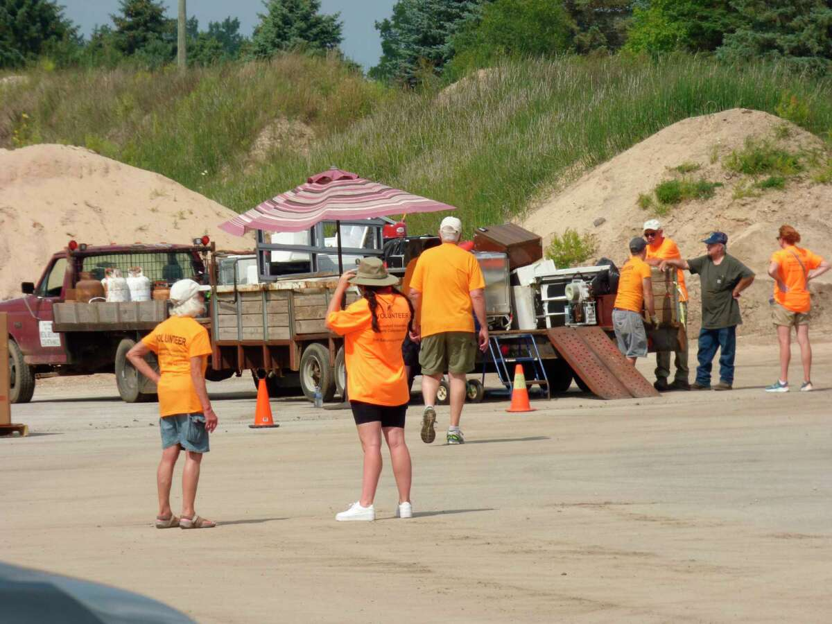 Volunteers direct traffic at the annual household hazardous waste collection held in Bear Lake on Aug. 21. (Scott Fraley/News Advocate)