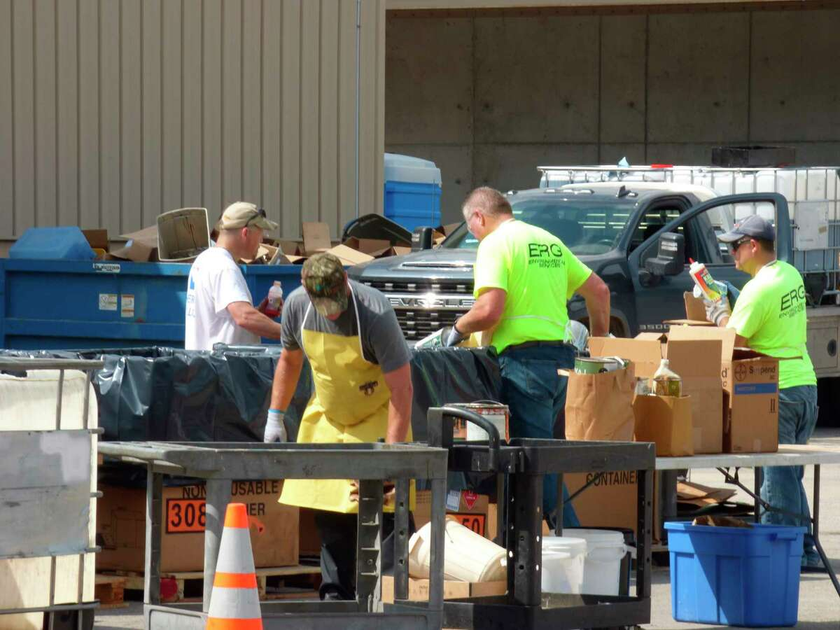 Waste handlerssortdisposed itemsat the annual countywide hazardous waste collection event in Bear Lake. (Scott Fraley/News Advocate)