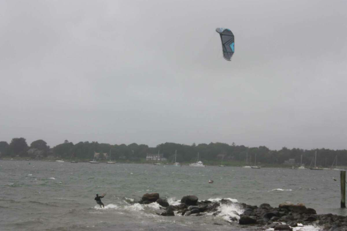 Michael Ferrara, of Stonington, went kite surfing Sunday afternoon at DuBois Beach after Tropical Storm Henri passed through the area.