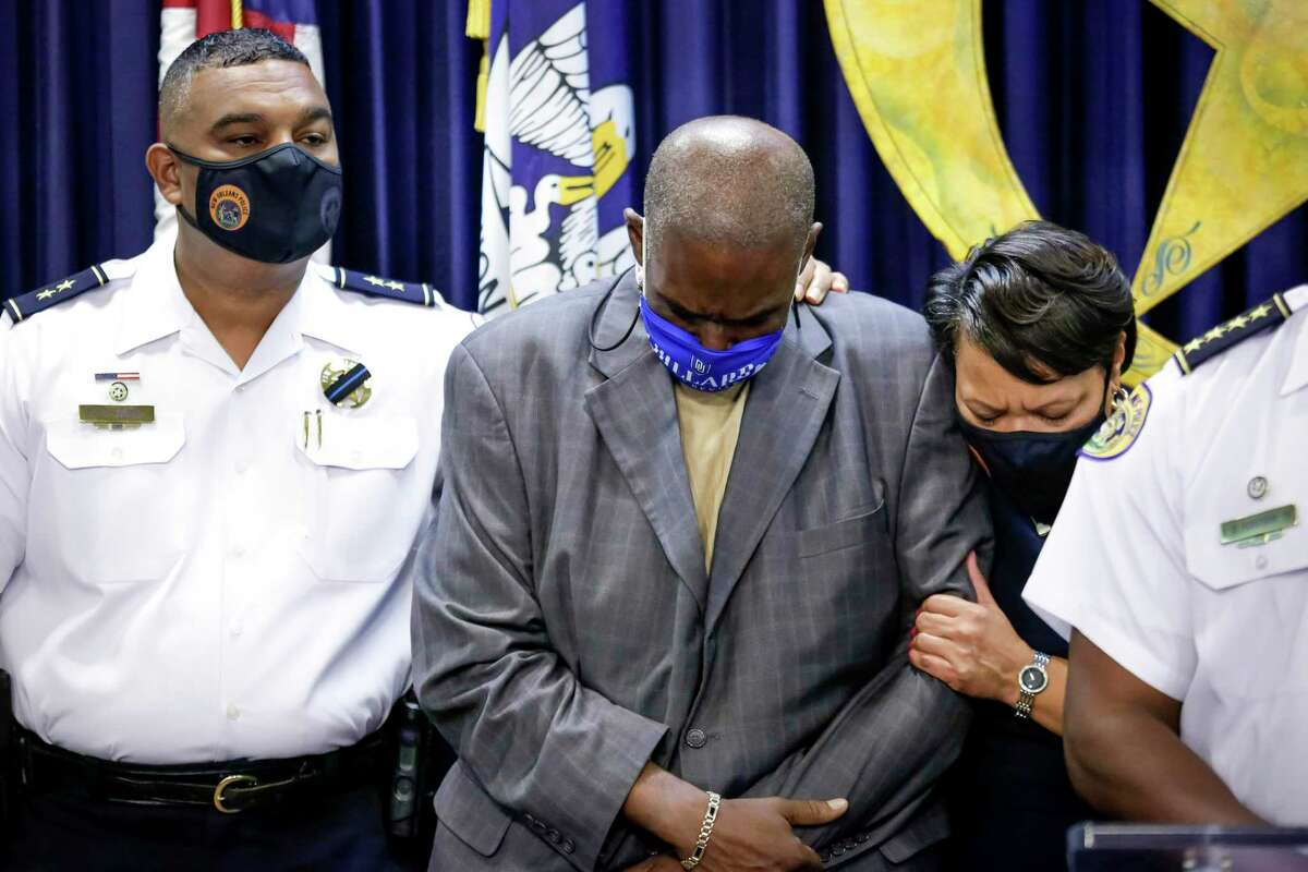 New Orleans Councilman Jay Banks, center, is consoled by NOPD Deputy Chief Christopher Goodly, left, and Mayor LaToya Cantrell during a press conference at NOPD Sunday, Aug. 22, 2021, to announce the death of detective Everett Briscoe, who was shot dead while on vacation Saturday at a restaurant in Houston. Banks is a longtime friend of Briscoe, both members of the Zulu Social Aid and Pleasure Club.